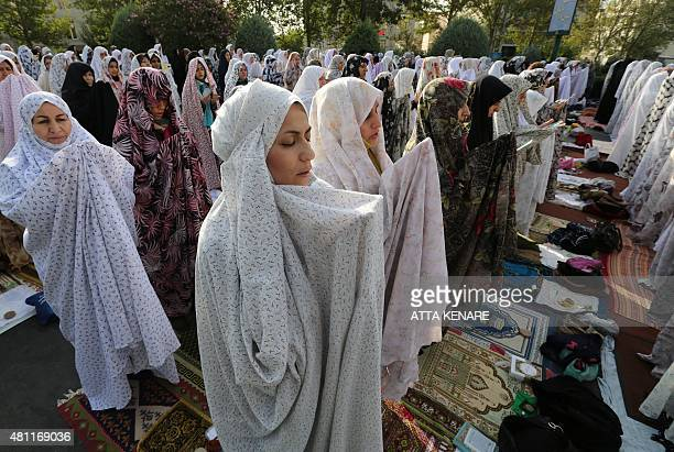 Iranian Muslim women perform the Eid alFitr prayers in western Tehran on July 18 2015 Eid which began on July 17 is the holiday that follows the...
