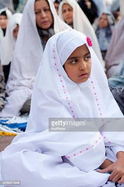 Iranian muslims attend Eid AlFitr prayer on 'emamzadeh saleh' on July 29 2014 in Tehran Iran Eid AlFitr marks the end of Ramadan the Islamic month of...