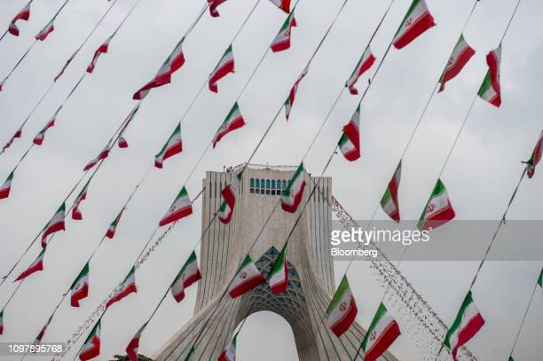 Iranian national flag bunting hangs in front of the Azadi Tower during the celebrations marking 40th anniversary of the Islamic revolution in Tehran...