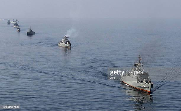 Iranian Navy boats take part in maneuvers during the Velayat90 navy exercises in the Strait of Hormuz in southern Iran on January 3 the End day of...