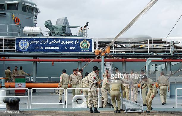 Iranian navy personnel stand aboard the IRIS Bushehr as two Iranian warships docked in the Sudanese Red Sea city of Port Sudan on December 8 2012 The...