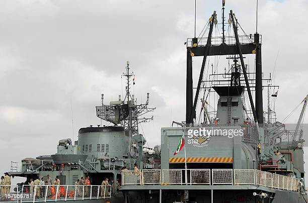 Iranian navy personnel stand aboard two Iranian warships docked in the Sudanese Red Sea city of Port Sudan on December 8 2012 The Iranian navy said...