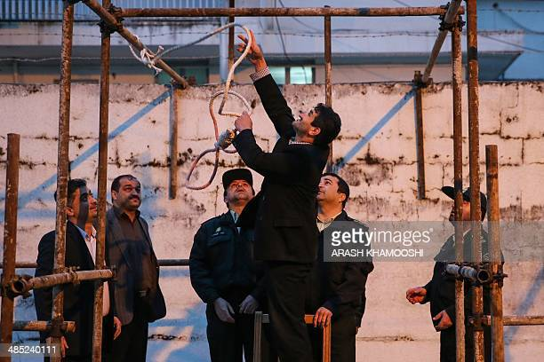 Iranian officials prepare the noose for the execution of Balal who killed fellow Iranian youth Abdolah Hosseinzadeh in a street fight with a knife in...