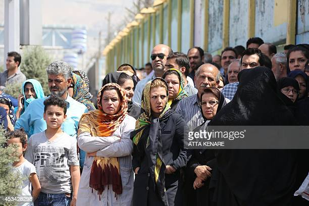 Iranian onlookers gather at the scene of a plane crash near Tehran's Mehrabad airport on August 10 2014 A civilian airliner crashed on takeoff near...