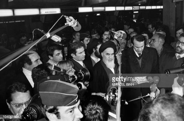 Iranian opposition leader in exile ayatollah Ruhollah Khomeiny gives a speech as journalists surround him at Roissy airport near Paris on January 31...