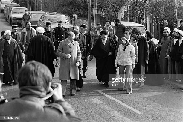 Iranian opposition leader in exile ayatollah Ruhollah Khomeiny walks out of his villa in NeauphleLeChâteau near Paris on January 31 1979 before...