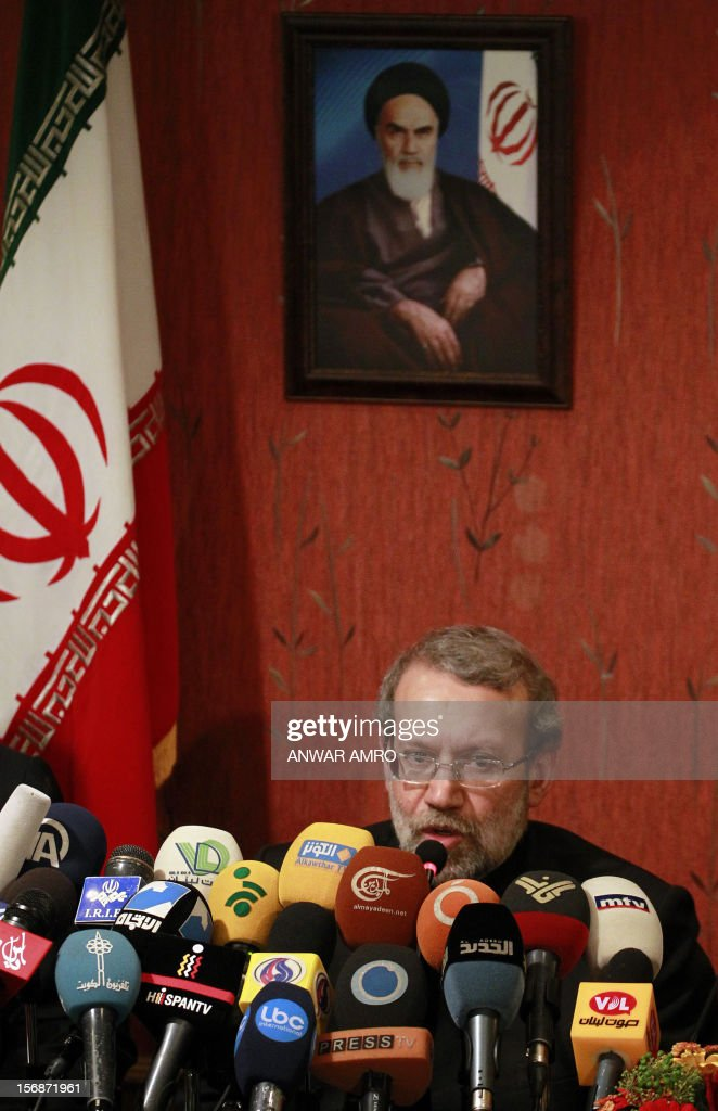 Iranian Parliament speaker Ali Larijani speaks under a picture of late founder of Islamic Republic, Ayatollah Ruhollah Khomeini, during a press conference at a hotel in the Lebanese capital, Beirut on November 23, 2012. Larijani began a regional tour to find a solution to the conflict in his country's key ally, Syria.