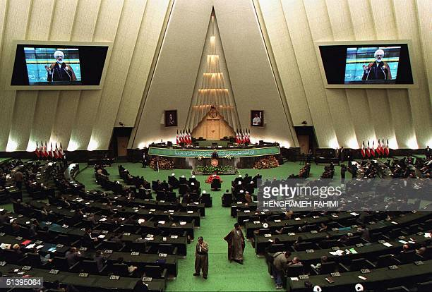 Iranian parliament speaker Mehdi Karubi addresses MPs at an opening ceremony of the new Majlis building 13 March 2001 in Tehran The building inspired...