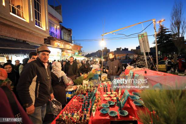 Iranian people are getting ready in Tehran for Persian New Year on March 20 2019 in Tehran Iran Nowruz is calculated according to a solar calendar...