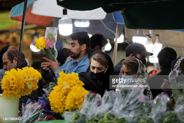 Iranian people buy produce as they get ready for Persian New Year on March 19, 2021 in Tehran, Iran. Nowruz is calculated according to a solar...