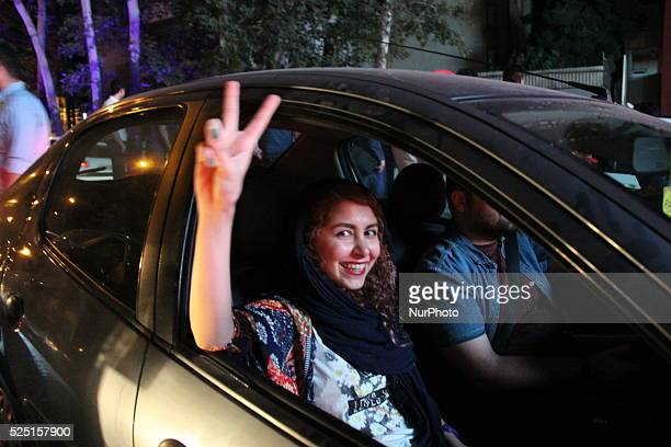 Iranian people celebrate the nuclear agreement between Iran and the P51 world powers on July 14 2015 in Tehran Iran Iran and the world powers group...
