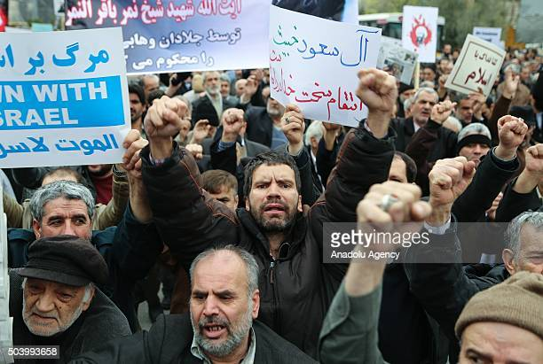 Iranian people hold banners and chant slogans against Saudi Arabia during the protest against execution of prominent Shiite cleric Nimr alNimr by...