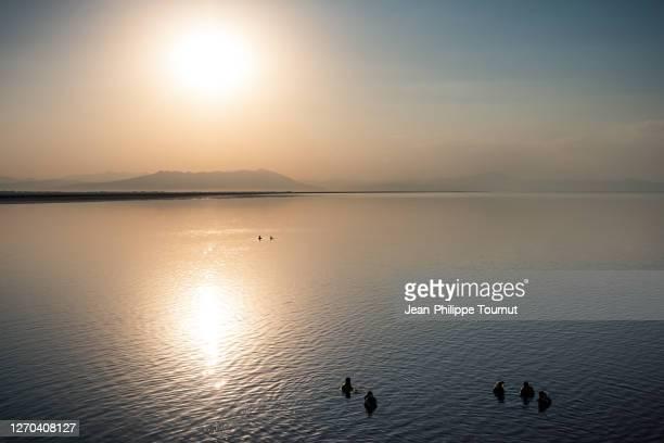iranian people swimming in urmia salt lake, iran - atmospheric mood stock pictures, royalty-free photos & images