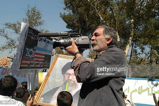 Iranian photographer and BBC cameraman Kaveh Golestan at a demonstration outside the US embassy in Tehran on the anniversary of its occupation 4th...