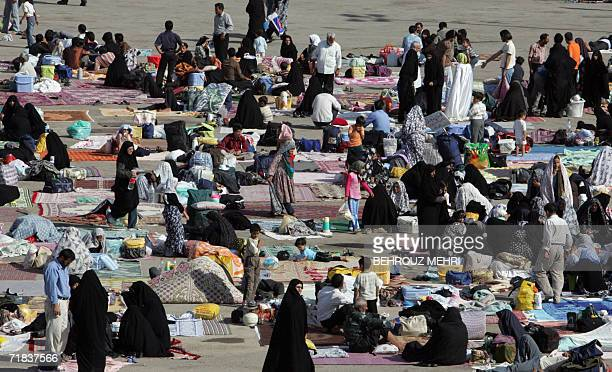 Iranian pilgrims spread carpets on the ground and picnic in the courtyard of the Jamkaran mosque outside the religious city of Qom 120 kms south of...