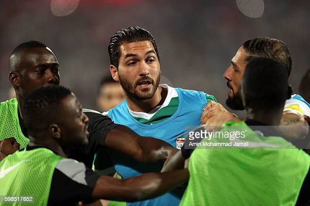 Iranian Player Alireza Haghighi and Qatar Players in fight during FIFA 2018 World Cup Qualifier match between Iran against Qatar on September 1 2016...