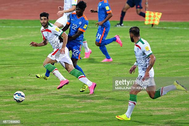 Iranian player Mehdi Taremi vies for the ball with Indian player Rowllin during the Group D FIFA World Cup 2018 qualifying football match between...