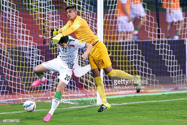 Iranian player Sardar Azmoun vies for the ball with Indian Goalkeeper Gurpreet Singh Sandhu during the Group D FIFA World Cup 2018 qualifying...