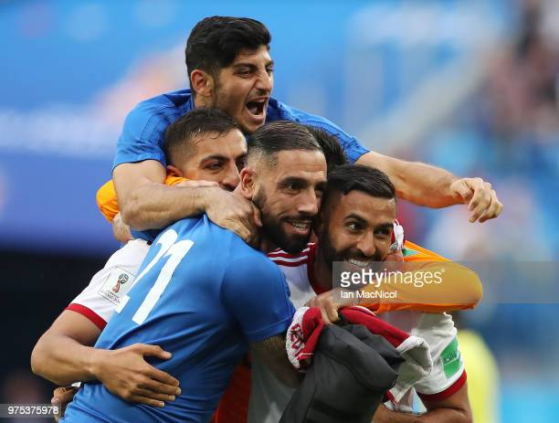 Iranian players celebrate at full time during the 2018 FIFA World Cup Russia group B match between Morocco and Iran at Saint Petersburg Stadium on...