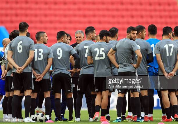 Iranian players listen to their coach during a training session before the group B match between Iran and Spain FIFA World Cup Russia 2018 at Kazan...