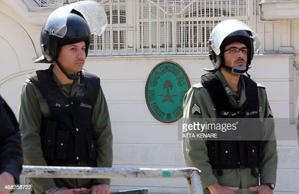 Iranian police stand guard outside the Saudi embassy as Yemeni students living in Iran take part in a demonstration in Tehran on April 1 to protest...