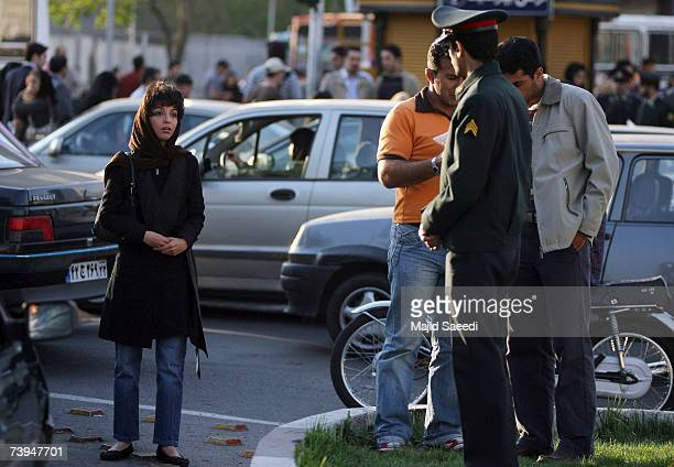 Iranian police warn a woman about her clothing and hair during a crackdown to enforce Islamic dress code on April 22 2007 in Tehran Iran Police...