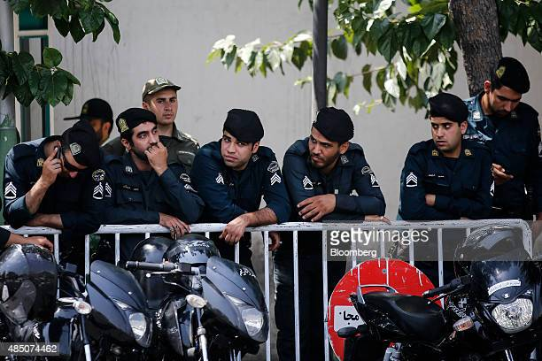 Iranian policemen stand guard outside the reopened British embassy in Tehran Iran on Sunday Aug 23 2015 Hammond was accompanied by officials from...
