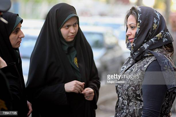 Iranian policewomen warn a woman about her clothing and hair during a crackdown to enforce Islamic dress code on April 22 2007 in Tehran Iran Police...