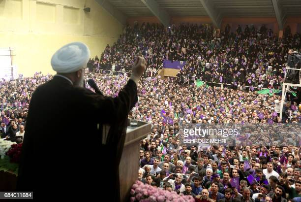 TOPSHOT Iranian President and candidate in the upcoming presidential elections Hassan Rouhani speaks during a campaign rally in the northwestern city...
