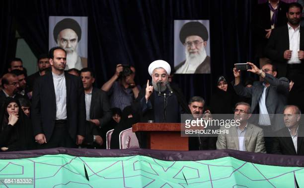 Iranian President and candidate in the upcoming presidential elections Hassan Rouhani gives an address at a campaign rally in Takhti stadium in the...
