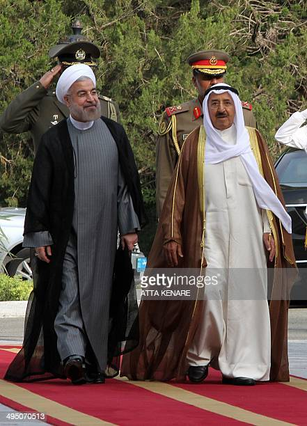 Iranian President Hassan Rouhani and Emir of Kuwait Sheikh Sabah alAhmad alSabah review the honor guard during a welcoming ceremony for the Emir upon...