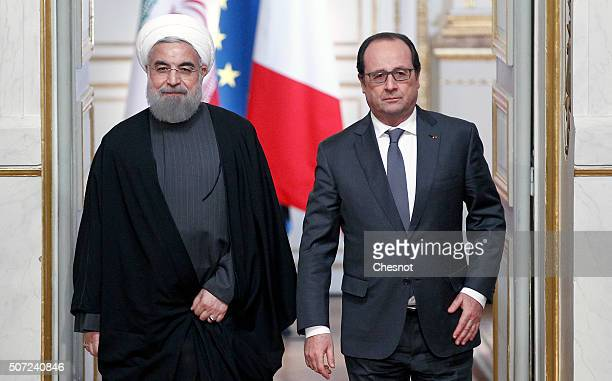 Iranian President Hassan Rouhani and French President Francois Hollande arrive to attend a press conference at the Elysee Presidential Palace on...