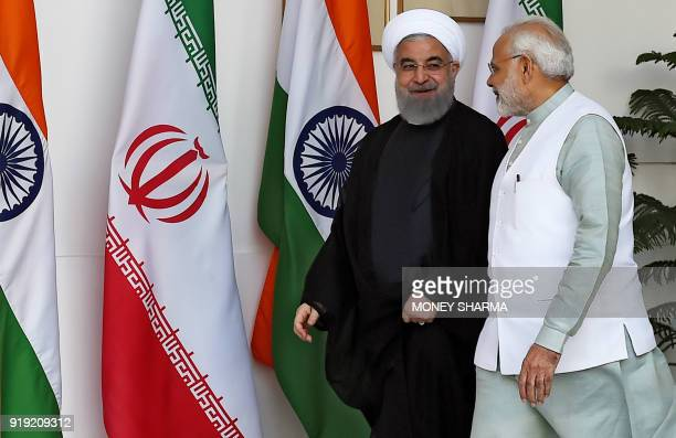 Iranian President Hassan Rouhani and Indian Prime Minister Narendra Modi arrive for a meeting at Hyderabad house in New Delhi on February 17, 2018. -...
