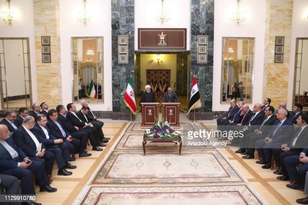 Iranian President Hassan Rouhani and Iraqi Prime Minister Adil Abdulmehdi hold a joint press conference following their meeting at the Iraqi Prime...