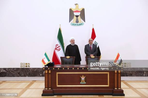 Iranian President Hassan Rouhani and Iraqi Prime Minister Adil Abdulmehdi meet at the Iraqi Prime Ministry Palace in Baghdad Iraq on March 11 2019