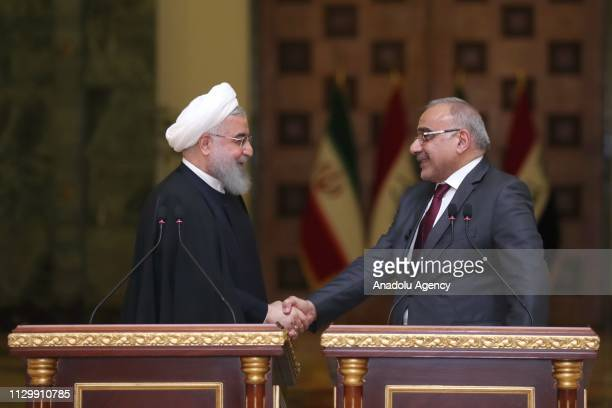 Iranian President Hassan Rouhani and Iraqi Prime Minister Adil Abdulmehdi shake hands during a joint press conference following their meeting at the...