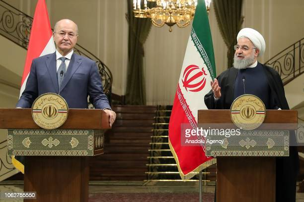 Iranian President Hassan Rouhani and Iraq's President Barham Salih hold a joint press conference after an interdelegation meeting at Sa'dabad Palace...