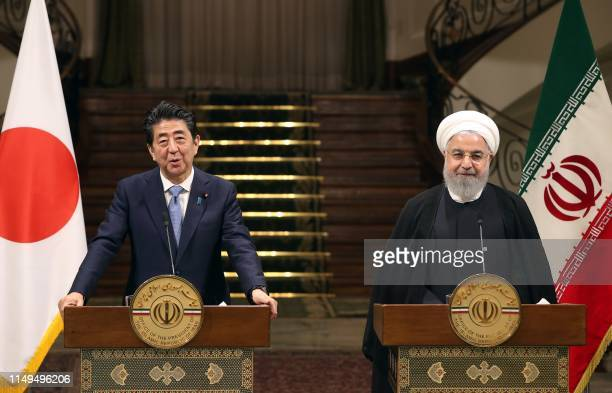Iranian President Hassan Rouhani and Japanese Prime Minister Shinzo Abe give a joint press conference at the Saadabad Palace in the Iranian capital...