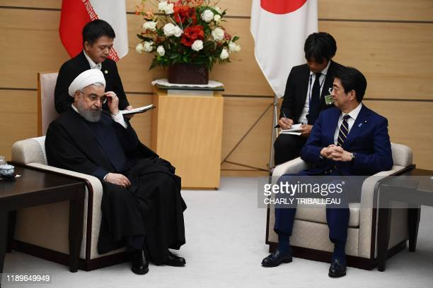 Iranian President Hassan Rouhani and Japanese Prime Minister Shinzo Abe attend a meeting at the prime minister's office in Tokyo on December 20, 2019.