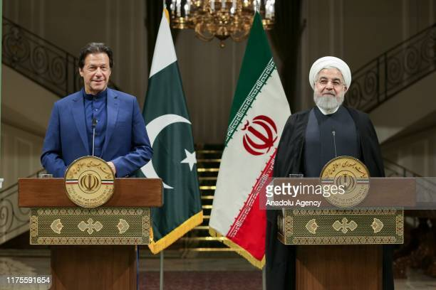 Iranian President Hassan Rouhani and Prime Minister of Pakistan Imran Khan hold a joint press conference after their meeting at Sa'dabad Palace...
