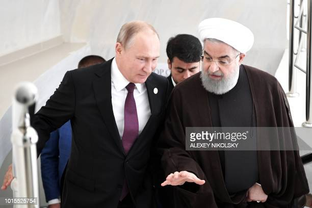Iranian President Hassan Rouhani and Russian President Vladimir Putin speak during their meeting at the 5th Caspian Summit in Aktau on August 12 2018