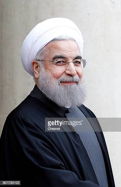 Iranian President Hassan Rouhani arrives to attend a meeting with French President Francois Hollande at the Elysee Presidential Palace on January 28...
