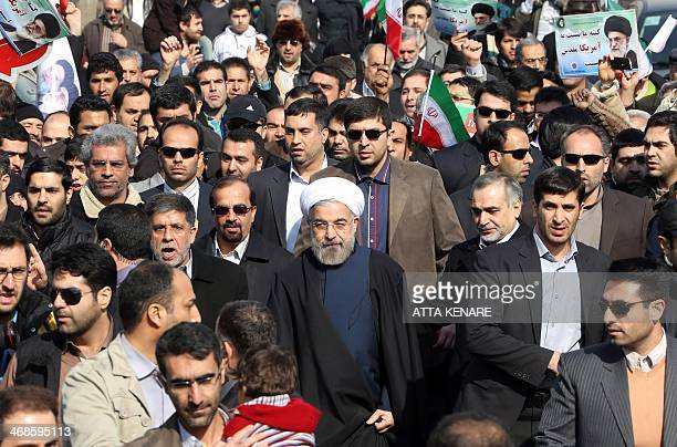 Iranian President Hassan Rouhani arrives to giving a speech during a rally in Tehran's Azadi Square to mark the 35th anniversary of the Islamic...