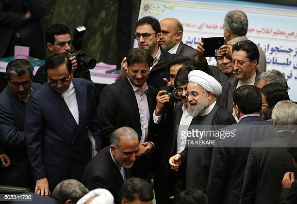 TOPSHOT Iranian President Hassan Rouhani arrives to parliament ahead of presenting the proposed annual budget in the capital Tehran on January 17...