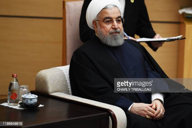 Iranian President Hassan Rouhani attend a meeting with Japanese Prime Minister Shinzo Abe at the prime minister's office in Tokyo on December 20 2019