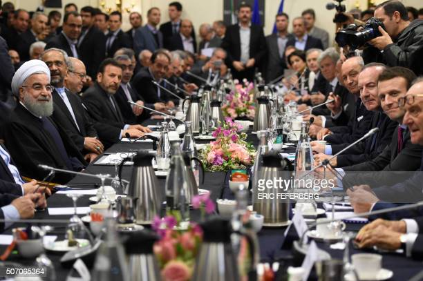 Iranian President Hassan Rouhani attends a meeting with French Economy Minister Emmanuel Macron , Movement of the Enterprises of France president...