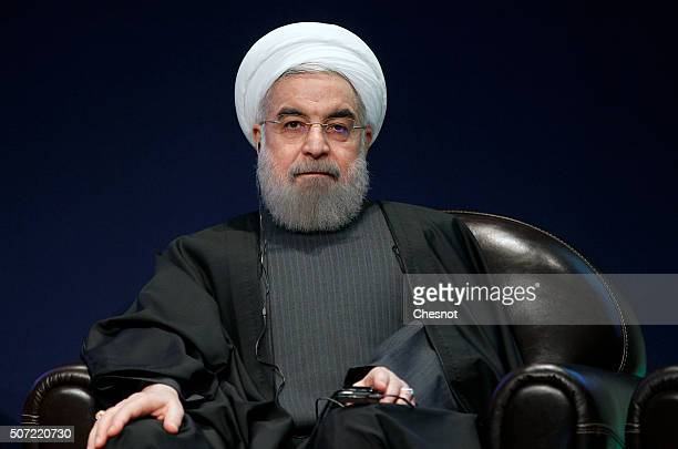 Iranian President Hassan Rouhani attends a meeting with the French Prime Minister Manuel Valls at the French employers association MEDEF headquarters...