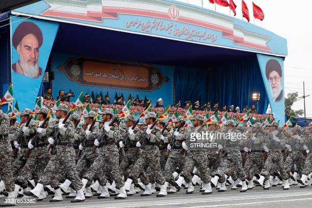 Iranian President Hassan Rouhani attends a military parade during a ceremony marking the country's annual army day in Tehran, on April 18, 2019. -...