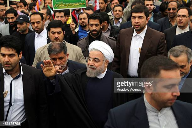 Iranian President Hassan Rouhani attends the 36th anniversary of the Islamic Revolution in Tehran's Azadi Square on February 11 2015