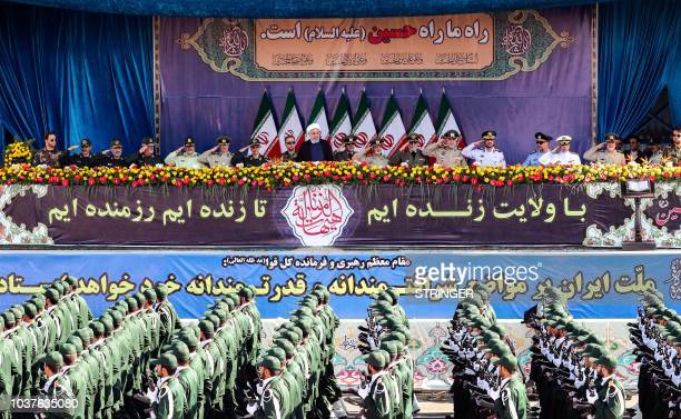 Iranian President Hassan Rouhani attends the annual military parade marking the anniversary of the outbreak of the devastating 19801988 war with...
